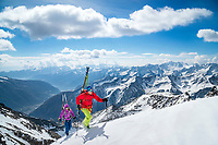 The Ortler Group in northern Italy is a popular region for spring ski touring using the huts for overnights to ski all the many peaks in the mountain group. Ski tourers on the summit ridge of the Punta Cadini, 3524 meters.