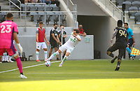 LOS ANGELES, CA - APRIL 17: Jared Stroud #20 of Austin FC crosses a ball during a game between Austin FC and Los Angeles FC at Banc of California Stadium on April 17, 2021 in Los Angeles, California.