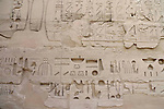 Hieroglyphs on a wall at Karnak.Karnak is part of the ancient city of Thebes ( built in and around modern day Luxor).The building of the Temple complex at Karnak began in the reign of the Pharaoh Senusret I who ruled Egypt from 1971-1926 BC. Approximately 30 Pharaohs contributed to the building of the complex and in so doing made it the largest ancient religious site in the world. The ancient name for Karnak was Ipet-isut (Most select of places).