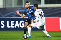 Berat Djimsiti of Atalnata and Casemiro of Real MAdrid compete for the ball during the Champions League round of 16 football match between Atalanta BC and Real Madrid at Atleti azzurri d'Italia stadium in Bergamo (Italy), February, 24th, 2021. Photo Image Sport  / Insidefoto