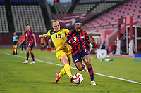 KASHIMA, JAPAN - AUGUST 5: Tameka Yallop #13 of Australia battles for the ball with Crystal Dunn #2 of the United States during a game between Australia and USWNT at Kashima Soccer Stadium on August 5, 2021 in Kashima, Japan.