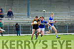 Kieran O'Leary Dr Crokes drives past Tadhg Morley  Templenoe during the SFC quarter final in Fitzgerald Stadium on Sunday