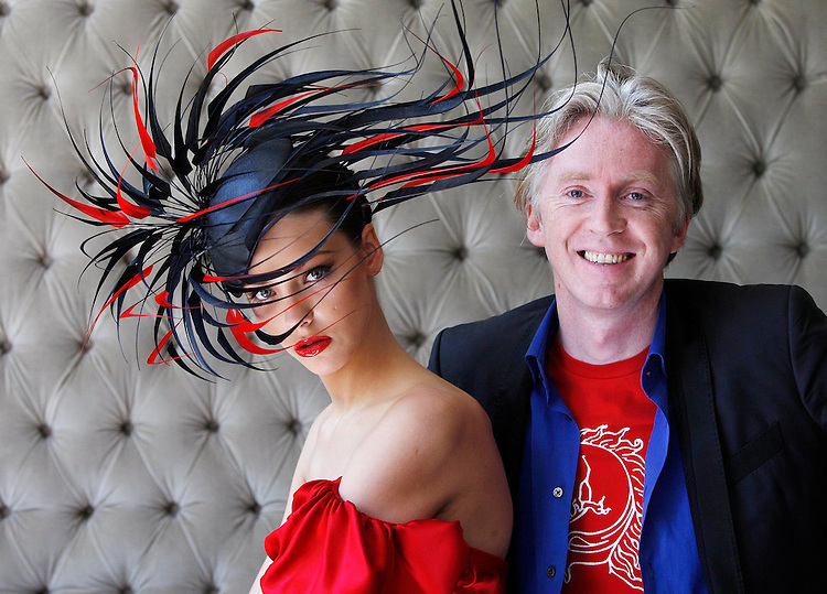 .Pictured is internationally renowned Irish designer, Philip Treacy with model Klaudia Molenda unveiling his latest creation inspired by Lyons Gold Blend tea on Tuesday 2nd June 2009 in the dylan Hotel, Dublin. The one of a kind hat was specially created to celebrate the rich qualities of Lyons Gold Blend, which new research has revealed as the best tasting gold blend tea, out performing competitors on taste, colour, flavour, appearance and mouth feel in both blind and branded research. The hat will be on display at the Lyons Gold Blend tent at Taste of Dublin 'where great taste meets great style' from 11th June 2009. One lucky person will win the bespoke Philip Treacy creation as Irish people will be able to enter a draw at the Lyons Gold Blend tent and online at www.lyonsgoldblend.ie. Photographer Robbie Reynolds. .