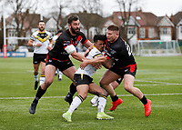 28th March 2021; Rosslyn Park, London, England; Betfred Challenge Cup, Rugby League, London Broncos versus York City Knights; Kieran Dixon of York City Knights tackled by Jacob Jones and Will Lovell of London Broncos
