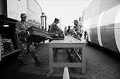 El Desengaño, Sinaloa<br /> Mexico<br /> June 13, 2007<br /> <br /> Over 140 Mexican military personal operate one of the largest anti-drug check-points in Mexico on the northern Sinaloa border, near Sonora. All vehicles, cars, buses, trucks and passengers are thoroughly inspected for illegal drugs as they head north.