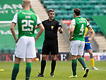 Hibs v St Johnstone…01.05.21  Easter Road. SPFL<br />Referee Greg Aitken has words with Paul Hanlon after his foul on Glenn Middleton<br />Picture by Graeme Hart.<br />Copyright Perthshire Picture Agency<br />Tel: 01738 623350  Mobile: 07990 594431