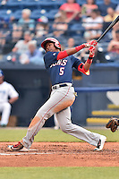 Hagerstown Suns third baseman Kelvin Gutierrez (5) swings at a pitch during a game against the Asheville Tourists at McCormick Field on April 26, 2016 in Asheville, North Carolina. The Suns defeated the Tourists 8-7. (Tony Farlow/Four Seam Images)