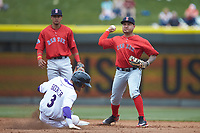 Salem Red Sox second baseman Carlos Tovar (11) turns a double play as Joel Booker (3) of the Winston-Salem Dash slides into second base at BB&T Ballpark on April 22, 2018 in Winston-Salem, North Carolina.  The Red Sox defeated the Dash 6-4 in 10 innings.  (Brian Westerholt/Four Seam Images)