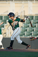 Giovanny Alfonzo (7) of the Greensboro Grasshoppers follows through on his swing against the Kannapolis Intimidators at Intimidators Stadium on July 17, 2016 in Greensboro, North Carolina.  The Grasshoppers defeated the Intimidators 5-4 in game two of a double-header.  (Brian Westerholt/Four Seam Images)