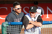 Lansing Lugnuts Justin Atkinson (5) and Andrew Case (37) in the dugout before a game against the Peoria Chiefs on June 6, 2015 at Cooley Law School Stadium in Lansing, Michigan.  Lansing defeated Peoria 6-2.  (Mike Janes/Four Seam Images)
