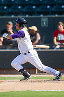 Justin Jirschele (11) of the Winston-Salem Dash follows through on his swing against the Wilmington Blue Rocks at BB&T Ballpark on July 6, 2014 in Winston-Salem, North Carolina.  The Dash defeated the Blue Rocks 7-1.   (Brian Westerholt/Four Seam Images)