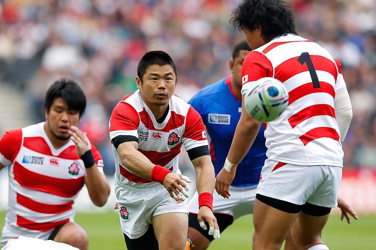 Japan Scrum-Half Fumiaki Tanaka passes - Mandatory byline: Rogan Thomson - 03/10/2015 - RUGBY UNION - Stadium:mk - Milton Keynes, England - Samoa v Japan - Rugby World Cup 2015 Pool B.