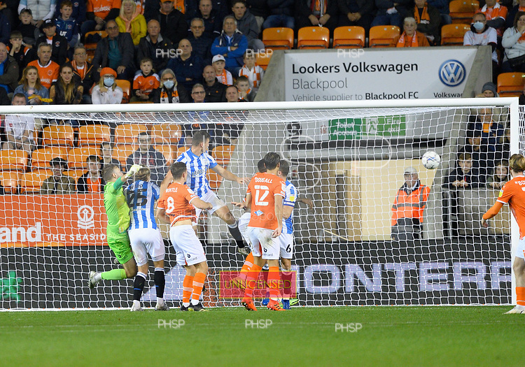14/09/2021 Sky Bet Championship Blackpool v Huddersfield Town  <br /> <br /> Matty Pearson climbs above Chris Maxwell and Marvin Ekpiteta to score Huddersfield Towns second goal