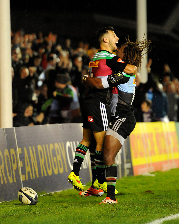 Danny Care of Harlequins celebrates scoring a try with team mate Marland Yarde of Harlequins during the European Rugby Champions Cup  Round 1 match between Harlequins and Castres Olympique at the Twickenham Stoop on Friday 17th October 2014 (Photo by Rob Munro)