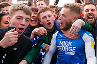 1st May 2021; Weston Homes Stadium, Peterborough, Cambridgeshire, England; English Football League One Football, Peterborough United versus Lincoln City; Fans celebrate with Joe Ward outside The Weston Homes Stadium after Peterborough United win promotion to the EFL Championship