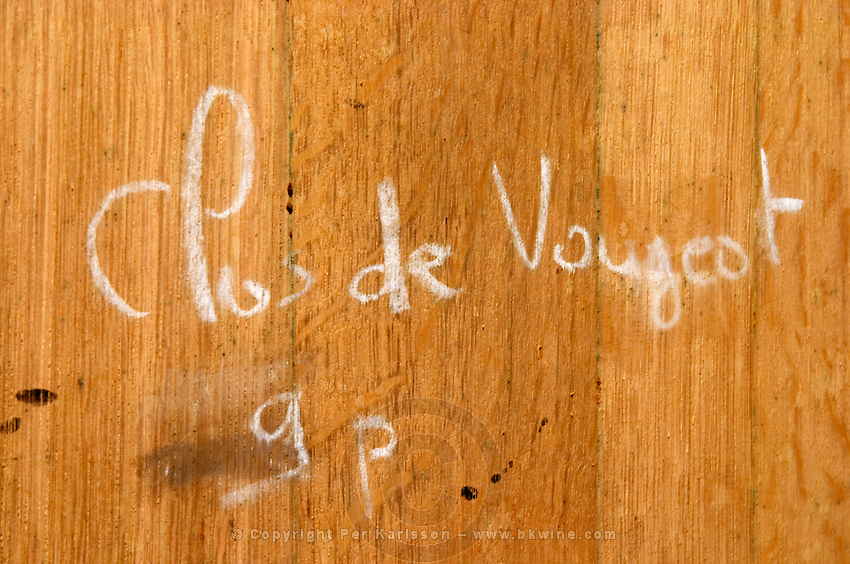 clos de vougeot in chalk hand writing on barrel clos des langres ardhuy nuits-st-georges cote de nuits burgundy france