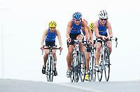 28 APR 2012 - LES SABLES D'OLONNE, FRA - Anastasia Polyanskaya (second from left) and Anna Maria Mazzetti (right) lead the Saint Raphael Triathlon team on the bike during the women's French Grand Prix Series triathlon prologue round in Les Sables d'Olonne, France (PHOTO (C) 2012 NIGEL FARROW)