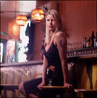 Woman with drink at bar