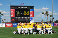 Michigan Wolverines team huddle before a game against Army West Point on February 17, 2018 at Tradition Field in St. Lucie, Florida.  Army defeated Michigan 4-3.  (Mike Janes/Four Seam Images)