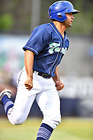 Asheville Tourists second baseman Coco Montes (5) runs to first base during a game against the West Virginia Power at McCormick Field on April 18, 2019 in Asheville, North Carolina. The Power defeated the Tourists 12-7. (Tony Farlow/Four Seam Images)