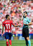 Referee Juan Martinez Munuera (r) shows Angel Correa of Atletico de Madrid the yellow card during the La Liga 2017-18 match between Atletico de Madrid and Sevilla FC at the Wanda Metropolitano on 23 September 2017 in Madrid, Spain. Photo by Diego Gonzalez / Power Sport Images