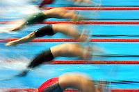 Men backstroke start blur.