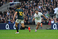 Billy Vunipola of England fumbles his own quick penalty tap in the rain during the QBE International match between England and South Africa at Twickenham Stadium on Saturday 15th November 2014 (Photo by Rob Munro)