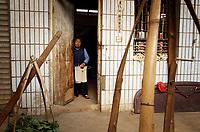 A woman in a market in Zijun village, home of the Samatao minority.
