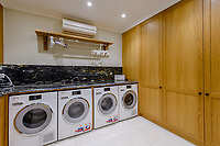 BNPS.co.uk (01202) 558833. <br /> Pic: TailorMade/BNPS<br /> <br /> Pictured: Utility room. <br /> <br /> A multi-millionaire is hoping to have a shot at selling his luxury mansion - by throwing a hi-tech golf simulator into the deal.<br />  <br /> Golf-loving Barry Bester put the waterfront property on Sandbanks, Dorset, on the market for £11m last year.<br />  <br /> He is now offering his £40,000 state-of-the-art simulator he has had built on the grounds with the sale.