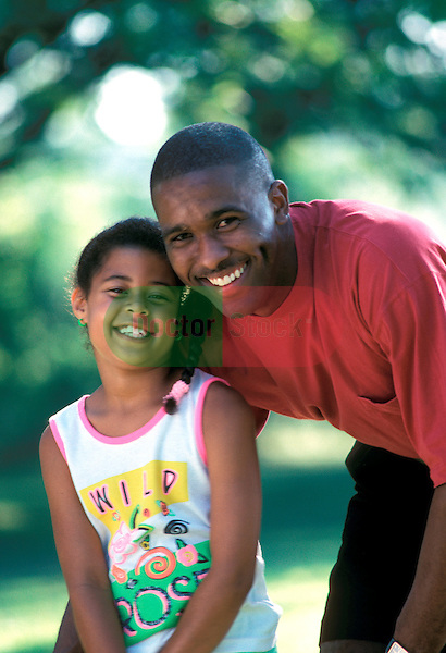smiling portrait of father and 12 year old daughter