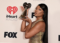 """HOLLYWOOD, CA - MAY 27:  Megan Thee Stallion with the award for Best Collaboration at the 2021 """"iHeartRadio Music Awards"""" airing live from The Dolby Theatre in Los Angeles, Thursday, May 27 (8:00-10:00 PM ET live / PT tape-delayed) on FOX. CR: Scott Kirkland/FOX/PictureGroup © 2021 FOX MEDIA, LLC. (Photo by Scott Kirkland/FOX/PictureGroup)"""