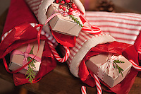 Close up of a pile of handmade Christmas stockings filled with presents