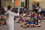 Radioactive Rachel demonstrates centripetal force during the Mad Science program at the Carson City Library, in Carson City, Nev., on Tuesday, July 15, 2014.<br />
