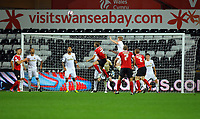 Pictured: Alan Tate of Swansea (in white TOP) heads the ball away from a Barnsley cross. Tuesday 28 August 2012<br /> Re: Capital One Cup game, Swansea City FC v Barnsley at the Liberty Stadium, south Wales.