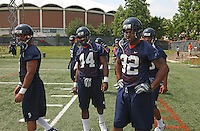 Offense players Mikell Simpson,(5), Raynard Horne(44) and running back Keith Payne(32) during open spring practice for the Virginia Cavaliers football team August 7, 2009 at the University of Virginia in Charlottesville, VA. Photo/Andrew Shurtleff