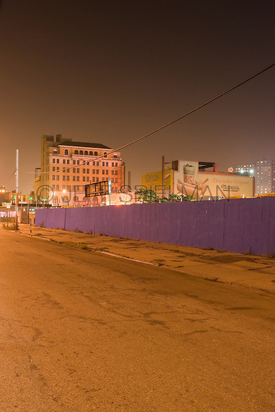 Coney Island at Night - Empty Street, Blue Wooden Fence, Nathan's Famous Hot Dog Restaurant and abandoned Shore Building (formerly a movie theater) in the background, Brooklyn, New York City, New York State, USA.   ....Coney Island in transition/before new development has commenced/summer of 2007