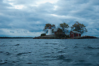 A sudden storm blew up from the West and hit me crosswise as I paddled solo in an open canoe across the St. Lawrence River to the lighthouse at Crossover Island which sits on the American side of the Can/US border. Fortunately, my tender craft did not upset into the chilly waters of the 1000 Islands in early November.