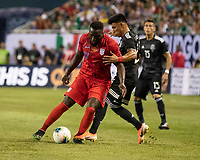 CHICAGO, IL - JULY 7: Jozy Altidore #17 is defended by Jesus Gallardo #23 during a game between Mexico and USMNT at Soldiers Field on July 7, 2019 in Chicago, Illinois.