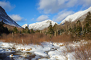 Eagle Cliff from along the Pemi Trail in Franconia Notch State Park of the New Hampshire White Mountains during the winter months.