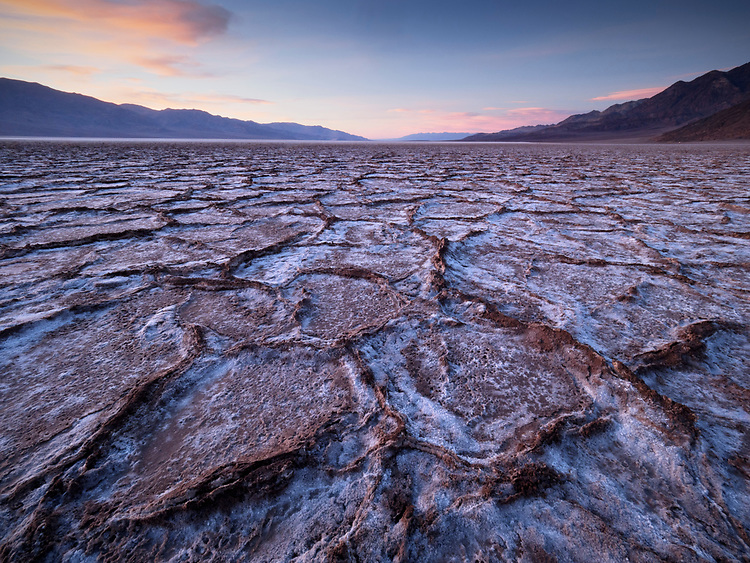 Geometric patterns of salt and mud near Badwater Salt Flats in Death Valley National Park in California, USA