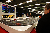 Visitors at theMontreal's AUTO SHOW 2007 <br /> take a break at the  Volkswagen booth to play with electic mini race cars<br /> <br /> photo :  Images Distribution