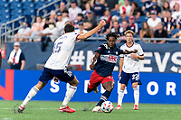 FOXBOROUGH, MA - AUGUST 18: DeJuan Jones #24 of New England Revolution takes a shot during a game between D.C. United and New England Revolution at Gillette Stadium on August 18, 2021 in Foxborough, Massachusetts.