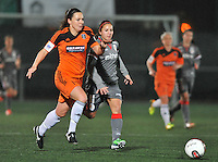 20131017 - GLASGOW , SCOTLAND :  Glasgow captain Rachel Corsie (left) pictured in a sprint with Standard's Vanity Lewerissa (right) during the female soccer match between GLASGOW City Ladies FC and STANDARD Femina de Liege , in the 1/16 final ( round of 32 ) second leg in the UEFA Women's Champions League 2013 in Petershill Park in Glasgow. First leg ended in a 2-2 draw . Thursday 17 October 2013. PHOTO DAVID CATRY