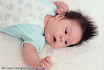 Baby boy, 7 weeks old on back, closeup, reflex tonic neck (fencing)