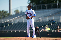 Scottsdale Scorpions relief pitcher Gerson Bautista (46), of the New York Mets organization, gets ready to deliver a pitch during an Arizona Fall League game against the Mesa Solar Sox at Scottsdale Stadium on November 2, 2018 in Scottsdale, Arizona. The shortened seven-inning game ended in a 1-1 tie. (Zachary Lucy/Four Seam Images)