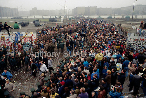 Berlin, Germany<br /> November 12, 1989<br /> <br /> East Germans cross the opening in the Berlin Wall at Potsdamer Platz. Germans gathered as the wall is dismantled and the East German government lifted travel and emigration restrictions to the West on November 9, 1989.