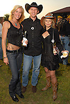 Janet Lloyd, James Polfreman and Tracy Polfreman at the Cattle Baron's Ball at the George Ranch Saturday April 28,2007.(Dave Rossman/For the Chronicle)