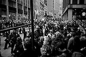 """New York, New York<br /> November 17, 2011<br /> <br /> """"Occupy Wall Street"""" protesters mark the movement's two-month milestone by marching from Zuccotti Park, in mass, to various access streets surrounding the New York Stock Exchange, which the police had barricaded off. Yet instead of the police keeping protesters out, protesters locked down those entrances to Wall Street and the New York Stock Exchange creating havoc as the police made more then 240 arrests to try and keep the streets open to normal traffic.<br /> <br /> At Broad Street and Exchange Place, just two blocks from the NYSE, Police try and contain a crowd of anti-Wall Street demonstrators from disrupting business as usual in the financial district. Dozens of arrests are made as protesters do battle with police."""