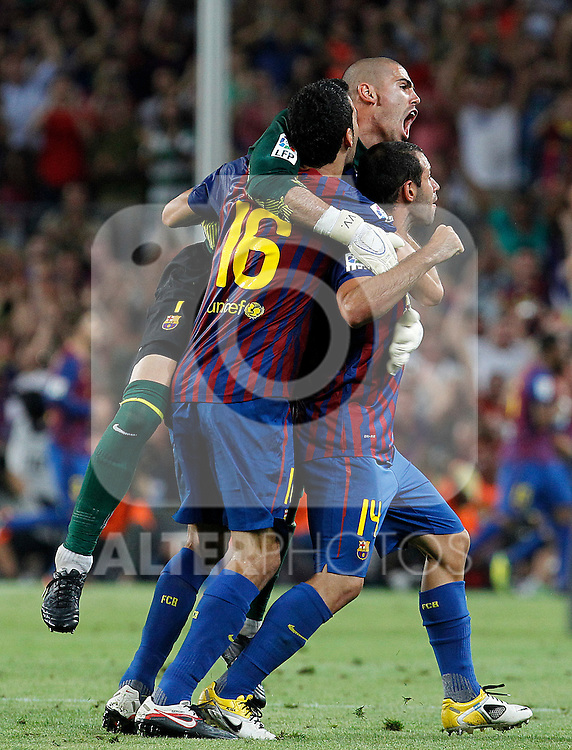 FC Barcelona's Victor Valdes (c), Sergio Busquets (l) and Javier Mascherano celebrates goal during Spanish Supercup 2nd match.August 17,2011. (ALTERPHOTOS/Acero)