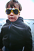 5 Year Old Boy posing with Charlie Brown Glasses on the beach.<br /> <br /> Stock Photo by Paddy Bergin